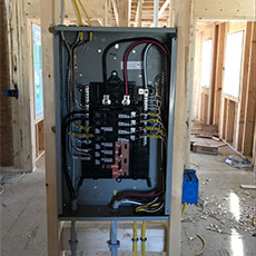 Electric service panel inside a newly constructed building