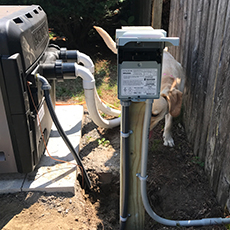 Electrical work for disconnect and pool heater, including electrical box on post.